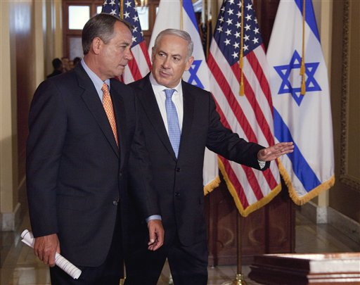Israeli Prime Minister Benjamin Netanyahu walks with House Speaker  John Boehner of Ohio to make a statement on Capitol Hill in Washington. (AP Photo/Evan Vucci)