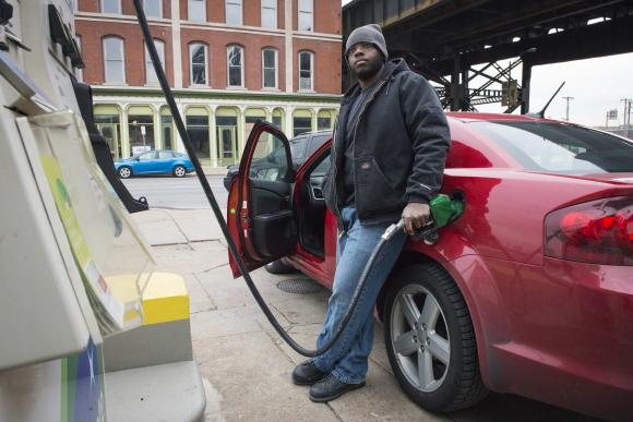 A man gets gasoline at a BP station in St. Louis, Missouri (REUTERS/Kate Munsch)