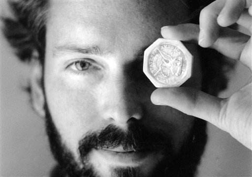 Tommy Thompson holds a $50 pioneer gold piece retrieved earlier in 1989 from the wreck of the gold ship Central America.  (AP Photo/The Columbus Dispatch, Lon Horwedel)