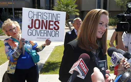 Christine Jones, right, a former legal counsel for the website hosting company GoDaddy, speaks after filing her nominating petitions to enter the Republican primary for Arizona governor in Phoenix.  (AP Photo/Ross D. Franklin)