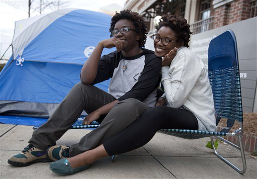 Shanté Wolfe, left and Tori Sisson, right, sit near the Montgomery County Courthouse.  (AP Photo/Brynn Anderson)