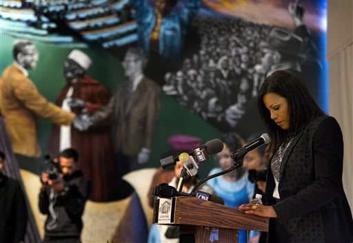Ilyasah Shabazz, daughter of Malcolm X, pauses for a moment of silence  Saturday. (AP Photo/Craig Ruttle)