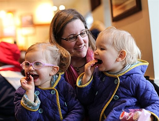 Michelle Moore with her twin daughters, Sierra, right,  and Savannah in Lake Oswego, Ore. (AP Photo/Gosia Wozniacka)