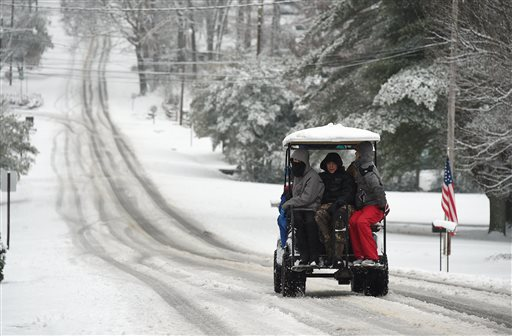 Will Lankford takes six of his friends on a ride in his big buggy golf cart in Gadsden, Ala.  (AP Photo/AL.com, Joe Songer)
