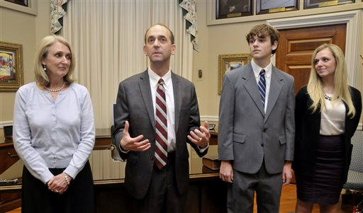 Tom Schweich, second from left, makes a few comments after his swearing-in ceremony in his Capitol office in Jefferson City. At left is his wife, Kathy, and to his right are son, Thomas Jr., and daughter Emile.  (AP Photo/News Tribune, Julie Smith)