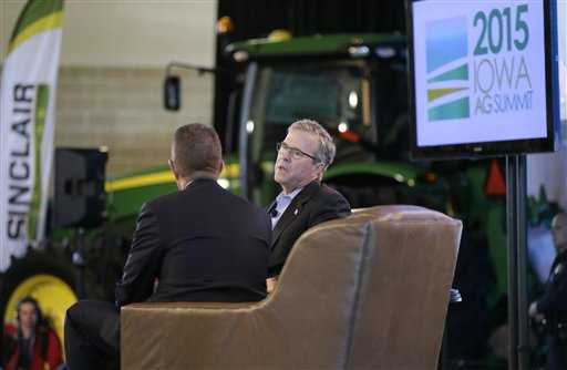 Former Florida Gov. Jeb Bush is interviewed by host Bruce Rastetter, left, during the Iowa Agriculture Summit in Des Moines, Iowa.  (AP Photo/Charlie Neibergall)