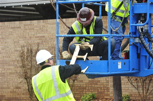 Facility workers removed the letters from the Sigma Alpha Epsilon house at the University of Oklahoma.  (AP Photo/Nick Oxford)