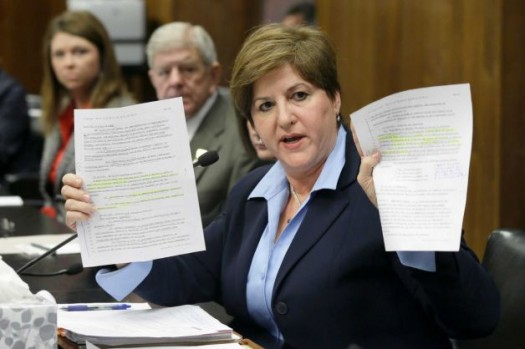Rep. Camille Bennett, D-Lonoke, holds copies of a bill she opposes at a meeting of the House Committee on Judiciary at the Arkansas state Capitol.  (Danny Johnston, AP)