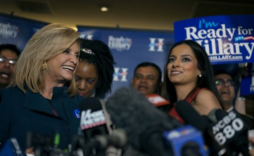 "Rep. Carolyn Maloney, D-N.Y., left, calls out to supporters during the ""Last Hillary Clinton Rally"" as part of the Ready for Hillary campaign in New York, Saturday, April 11, 2015. Jenifer Rajkumar, an official with the Ready for Hillary campaign in New York, looks on at right.  (AP Photo/Craig Ruttle)"