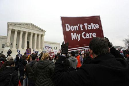 Demonstrators in favor of Obamacare gather at the Supreme Court building in Washington. (REUTERS/Jonathan Ernst)