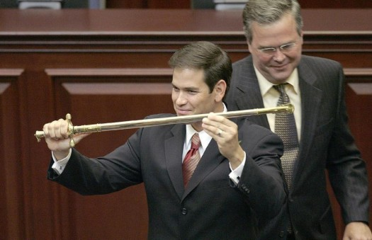 Marco Rubio, R-Miami, left, holds a sword presented to him by then-Gov. Jeb Bush, right, during ceremonies designating Rubio as the next Florida Speaker of the House. (AP Photo/Phil Coale)