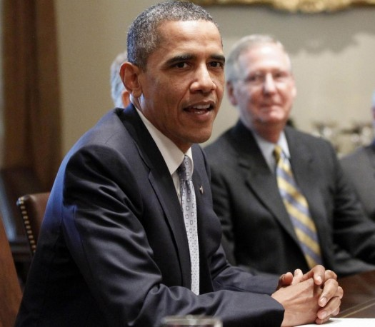 Senate Minority Leader Mitch McConnell of Ky. at with President Barack Obama.  (AP Photo/Charles Dharapak