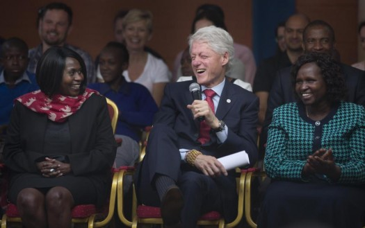 "Former President Bill Clinton, center, responds to a question from a pupil asking how the Clinton Foundation was started, as he and Chelsea Clinton talk about their foundation's ""No Ceilings"" project about the participation of women and girls globally, at the Farasi Lane Primary School in Nairobi, Kenya. (AP Photo/Ben Curtis)"