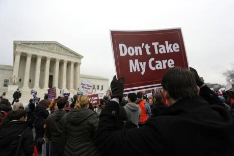 Demonstrators in favor of Obamacare gather at the Supreme Court building in Washington  (REUTERS/Jonathan Ernst)