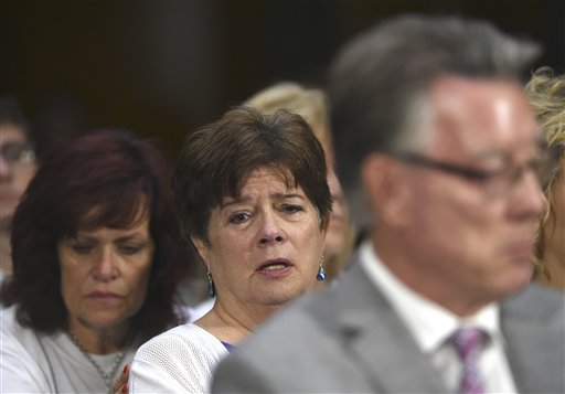 Liz Sullivan, mother of Kathryn Steinle, who was killed on a San Francisco Pier, allegedly by a man previously deported several times, listens to testimony behind Jim Steinle during a Senate Judiciary hearing to examine the Administration's immigration enforcement policies. (AP Photo/Molly Riley)