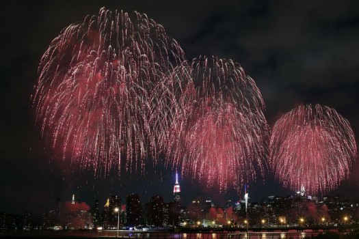 Fireworks explode over the East River in front of the Manhattan skyline as seen from the Brooklyn borough of New York during the Macy's Fourth of July fireworks show. (AP Photo/Jason DeCrow)
