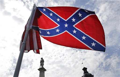 A protester waves a Confederate battle flag in front of the South Carolina statehouse, Thursday.  (AP Photo/John Bazemore)