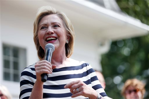 Presidential hopeful Hillary Clinton meets with a group of supports in the backyard of a Beaverdale, Iowa, home on Saturday, July 25, 2015.  (Kelsey Kremer/The Des Moines Register via AP)