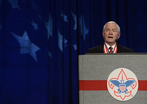 FILE - In this May 23, 2014, file photo, former Defense Secretary Robert Gates addresses the Boy Scouts of America's annual meeting in Nashville, Tenn., after being selected as the organization's new president. Gates said at the meeting two days earlier that the organization's long-standing ban on participation by openly gay adults was no longer sustainable. The Boy Scouts of America's top policy-making board planned a vote Monday, July 27, 2015, on ending its blanket ban on gay adult leaders while allowing church-sponsored Scout units to maintain the exclusion if that accorded with their faith.  (AP Photo/Mark Zaleski, File)