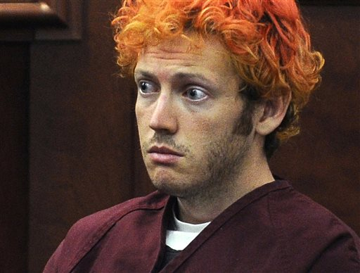FILE - In this July 23, 2012, file photo, James Holmes, who is charged with killing 12 moviegoers and wounding 70 more in a shooting spree in a crowded theatre in 2012, sits in Arapahoe County District Court in Centennial, Colo. Jurors in the Colorado theater shooting case reached a decision Friday, Aug. 7, 2015, on whether Holmes should be sentenced to life in prison or the death penalty. The same jurors rejected Holmes' insanity defense and convicted him of murder.(RJ Sangosti/The Denver Post via AP, Pool, File)