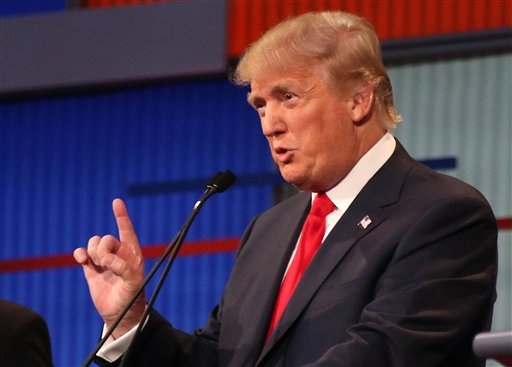 Republican presidential candidate Donald Trump speaks listens during the first Republican presidential debate at the Quicken Loans Arena Thursday, Aug. 6, 2015, in Cleveland. (AP Photo/Andrew Harnik)