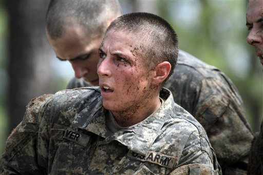 In this photo taken on April 26, 2015, one of the 20 female soldiers, who is among the 400 students who qualified to start Ranger School, tackles the Darby Queen obstacle course, one of the toughest obstacle courses in U.S. Army training, at Fort Benning, in Ga. Two women have now passed the U.S. Army's grueling Ranger test, and even tougher and more dangerous jobs could lie ahead. The military services are poised to allow women to serve in most front-line combat jobs, including special operations forces, senior officials told The Associated Press. (Robin Trimarchi/Ledger-Enquirer via AP) MANDATORY CREDIT