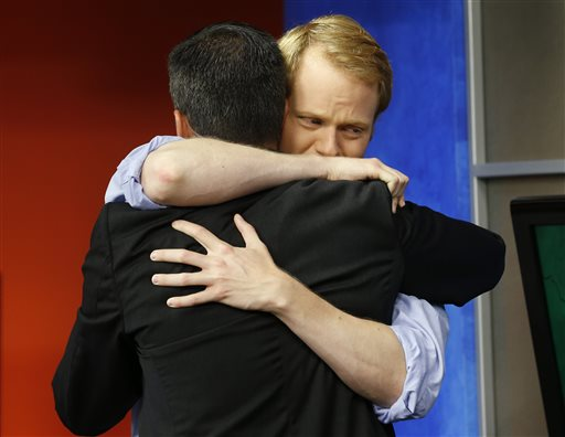 WDBJ-TV7 anchor Chris Hurst, right, hugs meteorologist Leo Hirsbrunner during the early morning newscast at WDBJ-TV7, in Roanoke, Va., Thursday, Aug. 27, 2015. Hurst was the fiance of Alison Parker, who was killed during a live broadcast Wednesday, in Moneta. (AP Photo/Steve Helber)