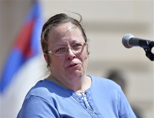 Rowan County Kentucky Clerk Kim Davis shows emotion as she is cheered by a gathering of supporters during a rally on the steps of the Kentucky State Capitol in Frankfort Ky., Saturday, Aug. 22, 2015. Davis spoke at the rally organized by The Family Foundation of Kentucky. The crowd of a few thousand included churchgoers from around the state. Davis has been sued by The American Civil Liberties Union for denying marriage licenses to gay couples. She says her Christian faith prohibits her from signing licenses for same-sex couples. (AP Photo/Timothy D. Easley)