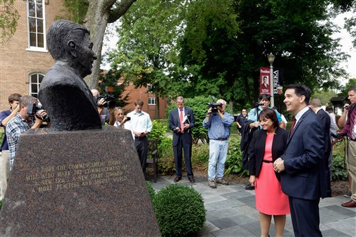 Republican presidential candidate, Wisconsin Gov. Scott Walker, right, and his wife Tonette, admire a bust of former president Ronald Reagan, in the Ronald Reagan Peace Garden, after speaking at Eureka College during a campaign stop, Thursday, Sept. 10, 2015, in Eureka, Ill. (AP Photo/Seth Perlman)