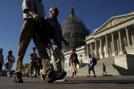 Tourists walk past the Capitol. (REUTERS/Jonathan Ernst)