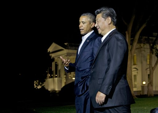 President Barack Obama and Chinese President Xi Jinping, right, walk on the North Lawn of the White House in Washington, Thursday, Sept. 24, 2015, for a private dinner at the Blair House, across the street from the White House. Xi arrived in Washington late Thursday for a State Visit. Obama has invested more time building personal ties with the Chinese president than with most other world leaders. (AP Photo/Manuel Balce Ceneta)