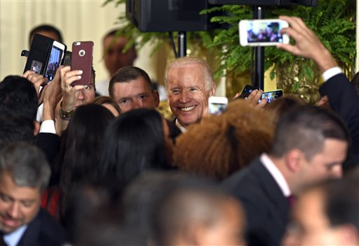 Vice President Joe Biden greets the crowd at a reception in the East Room of the White House in Washington, Thursday, Oct. 15, 2015, for Hispanic Heritage Month and the 25th anniversary of the White House Initiative on Educational Excellence for Hispanics. (AP Photo/Susan Walsh)