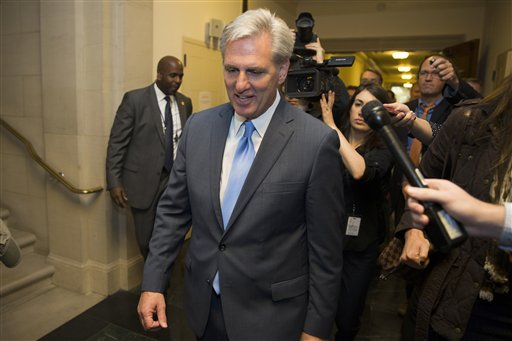 House Majority Leader of Kevin McCarthy of Calif. walks out of nomination vote meeting on Capitol Hill in Washington, Thursday, Oct. 8, 2015, after dropping out of the race to replace House Speaker John Boehner. In a stunning move, McCarthy withdrew his candidacy for House speaker Thursday, throwing Congress' Republican leadership into chaos. (AP Photo/Evan Vucci)