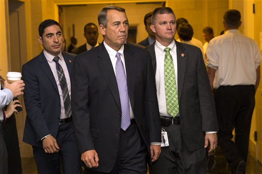 Outgoing House Speaker John Boehner of Ohio arrives for a meeting where Republicans will nominate candidates to replace him, Thursday, Oct. 8, 2015, on Capitol Hill in Washington. (AP Photo/Evan Vucci)