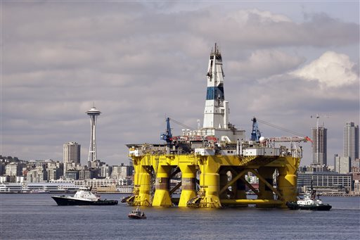 FILE - In this May 14, 2015, file photo, the Royal Dutch Shell oil drilling rig Polar Pioneer is towed toward a dock in Elliott Bay in Seattle. Three weeks after Royal Dutch Shell announced it was walking away from exploratory drilling in U.S. Arctic waters, the Obama administration has taken steps to keep drill rigs out of Alaska's northern ocean for a decade or more. Interior Secretary Sally Jewell announced Friday, Oct. 16, 2015, the federal government is cancelling federal petroleum lease sales in U.S. Arctic waters that were scheduled for 2016 and 2017. (AP Photo/Elaine Thompson, File)