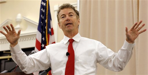 FILE - In this Oct. 9, 2015, file photo, Republican presidential candidate Sen. Rand Paul, R-Ky. speaks during a campaign stop at the Republican Liberty Caucus in Nashua, N.H.  A defiant Paul is brushing off weak fundraising and weaker poll numbers as some Republicans begin pushing him to abandon his presidential ambitions to focus on his Senate re-election. The first-term Kentucky senator this week claimed his superior political organization would prove wrong those doubting his chances in the White House contest. (AP Photo/Jim Cole, File)
