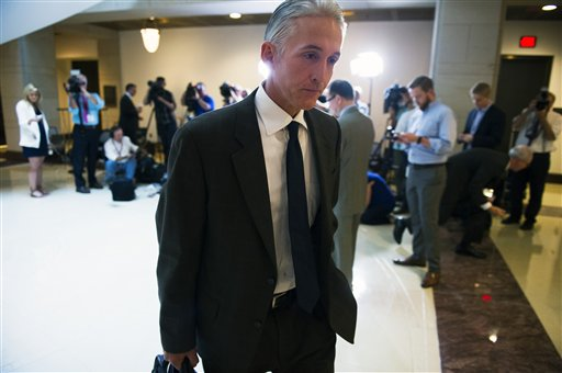 FILE - In this Sept. 4, 2015, file photo, House Benghazi Committee Chairman Trey Gowdy, R-S.C., walks to a hearing room on Capitol Hill in Washington.  Gowdy is a man under siege. The three-term Republican congressman from South Carolina chairs the embattled House committee investigating the deadly 2012 attacks in Benghazi, Libya.    (AP Photo/Cliff Owen, File)