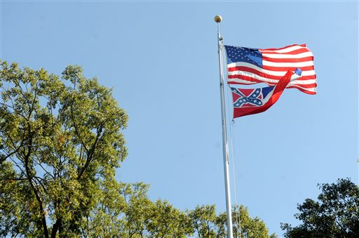 In a October 16, 2015 photo, the Mississippi state flag and U.S. flag fly in the Circle on campus at the University of Mississippi in Oxford, Miss. The state flag was removed Monday, Oct, 26, 2015, days after the student senate, the faculty senate and other groups adopted a student-led resolution calling for removal of the banner from campus.  (Bruce Newman/Oxford Eagle via AP)