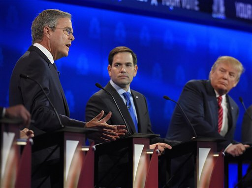 Marco Rubio, center, and Jeb Bush, left, argue a point as Donald Trump looks on during the CNBC Republican presidential debate at the University of Colorado, Wednesday, Oct. 28, 2015, in Boulder, Colo. (AP Photo/Mark J. Terrill)