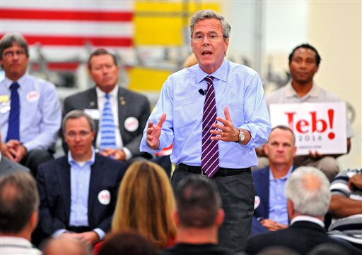 """Jeb Bush talks about his record as Florida governor and his hopes for his presidency as a part of his """"Jeb Can Fix It"""" tour. The Republican presidential candidate held a """"town hall"""" event at Kaman Aerospace in Jacksonville, Fla., on Monday Nov. 2, 2015. (AP Photo/The Florida Times-Union, Bob Mack)"""