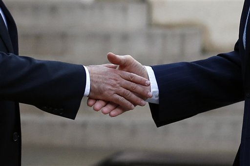 French President Francois Hollande, left, shakes hands with US Secretary of State John Kerry, upon arrival at the Elysee Palace, in Paris, France, Tuesday, Nov. 17, 2015. Kerry arrived in Paris to pay tribute to last Friday November 13 attacks in France. (AP Photo/Francois Mori)