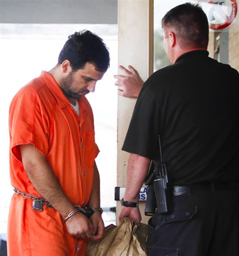 In this June 8, 2011 photo, Iraqi refugee Waad Ramadan Alwan, left, of Bowling Green, who is facing terrorism charges, arrives at the William H. Natcher Federal Courthouse for a detention hearing in Bowling Green, Ky. From a Kentucky college town, Alwan and Mohanad Shareef Hammadi, Iraqi refugees, plotted to send sniper rifles, Stinger missiles and money to al-Qaida operatives waging an insurgency back home against U.S. troops. The scheme was foiled and both are in prison, but the case has left jitters about whether terrorists might slip in among Syrian refugees resettling in the U.S. (Daily News via AP) MANDATORY CREDIT