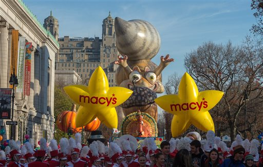 Performers stand in front of balloons at the start of the Macy's Thanksgiving Day Parade, Thursday Nov. 26, 2015, in New York.  (AP Photo/Bryan R. Smith)