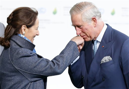 Britain's Prince Charles is greeted by Segolene Royal, Minister for Ecology, Sustainable Development and Energy as he arrives for the COP21, United Nations Climate Change Conference, in Le Bourget, outside Paris, Monday, Nov. 30, 2015. (Guillaume Horcajuelo/Pool via AP)