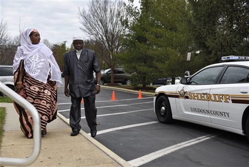 Members of the congregation arrive at the All Dulles Area Muslim Society (ADAMS) Center in Sterling, Va., Friday, Dec. 18, 2015. Religious congregations across the United States are concentrating on safety like never before following a season of violence, from the slaughter unleashed in June 2015 by a white shooter at a historically black church in Charleston, S.C., to the killings this month in San Bernardino, Calif. (AP Photo/Sait Serkan Gurbuz)