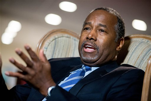 """FILE -- In this Dec. 23, 2015 file photo, Republican presidential candidate Dr. Ben Carson speaks in his home in Upperco, Md. Two of Carson's top paid advisers are leaving the campaign with only a month to go before Iowa's leadoff caucuses. That's according to Carson's Iowa director, Ryan Rhodes. He says Carson campaign manager Barry Bennett and senior campaign spokesman Doug Watts are """"out"""" as of Thursday. (AP Photo/Andrew Harnik, File)"""