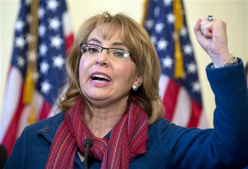 FILE - In this March 4, 2015 file photo, former U.S. Rep. Gabby Giffords, D-Ariz., speaks on Capitol Hill in Washington, about bipartisan legislation on gun safety. In past five years, Giffords has hiked the Grand Canyon, raced in a 40-mile bike ride, sky dived and founded an advocacy group that helped convince President Obama to take executive action on gun control. (AP Photo/Carolyn Kaster, File)
