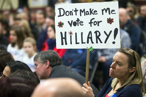 An attendee holds a sign as Democratic presidential candidate, Sen. Bernie Sanders, I-Vt., speaks during a campaign stop at Bedford High School, Friday, Jan. 22, 2016, in Bedford. (AP Photo/John Minchillo)
