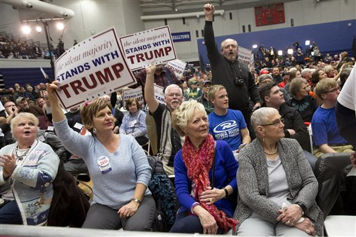 Supporters of Republican presidential candidate Donald Trump cheer to drown out protestors chants during a campaign event at the Roundhouse Gymnasium, Tuesday, Jan. 26, 2016, in Marshalltown, Iowa. (AP Photo/Mary Altaffer)