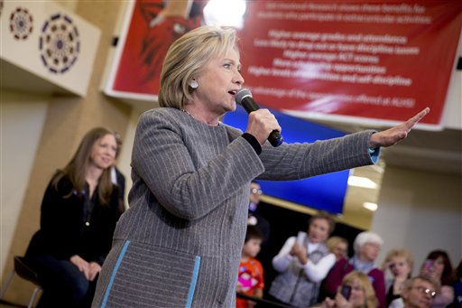 Democratic presidential candidate Hillary Clinton, accompanied by her daughter Chelsea Clinton, left, speaks at a rally at Abraham Lincoln High School in Council Bluffs, Iowa, Sunday, Jan. 31, 2016. (AP Photo/Andrew Harnik)